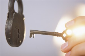 Hand Unlocking Old Fashioned Lock